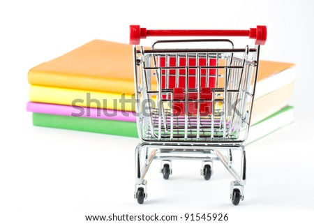 Shopping for Books. Shopping Cart with books on the white background