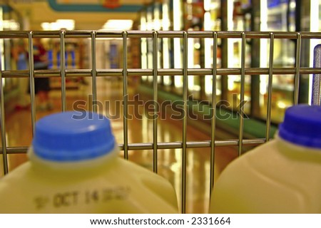Shopping for food in the supermarket... looking out thru the front of the cart - stock photo