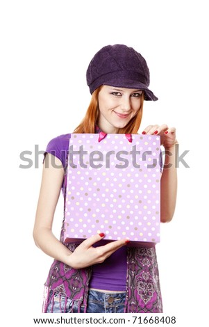 Shopping girl in violet with bag. Studio shot. - stock photo