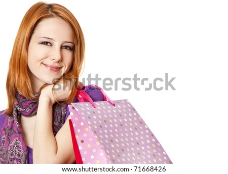 Shopping girl in violet with bag. Studio shot.