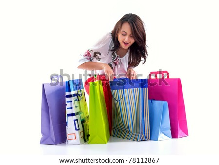 Shopping girl look over shopping bags,isolated on white background - stock photo