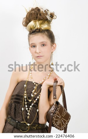 Shopping girl showing off fashion jewellery and handbag