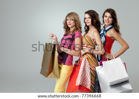 shopping girlfriends posing happy at camera - stock photo