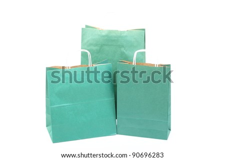 Shopping green gift bags isolated on white background