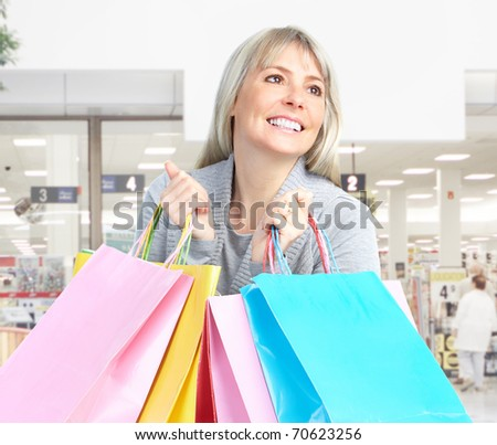 Shopping happy  mature  woman at the mall - stock photo