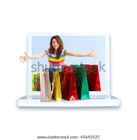 Shopping happy woman and laptop. Isolated over white background