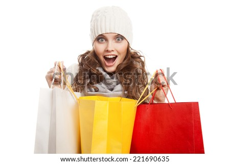 Shopping happy woman holding bags. Winter sales. - stock photo
