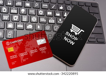 Shopping Icons on Keyboard keys with smart phone and credit card