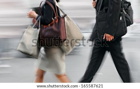 shopping in the city in motion blur - stock photo