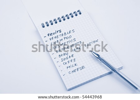 Shopping list handwritten with blue pen in a notebook - stock photo
