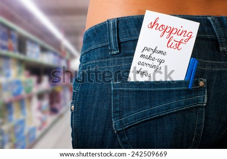 Shopping list in the supermarket in the back pocket of her jeans