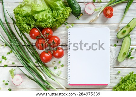shopping list with vegetables. Salad vegetable, recipe book, copy space - stock photo