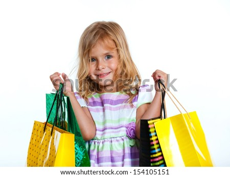 Shopping little girl happy smiling holding shopping bags isolated on white background. - stock photo