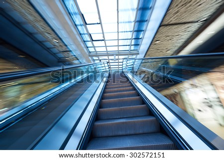 Shopping mall center escalators. Zoom blur movement. - stock photo