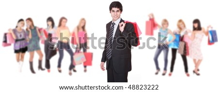 Shopping man with group of shopping girls over white background