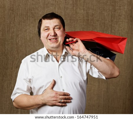 Shopping man with red and blue bags. - stock photo