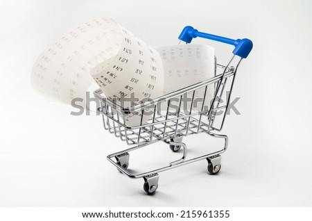 Shopping money. Receipt and calculator in shopping trolley - stock photo