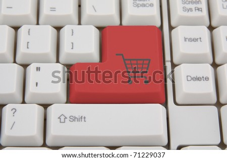 Shopping on-line , red key with basket symbol - stock photo