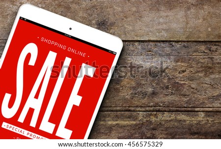 shopping online concept, tablet computer on old wooden table  - stock photo