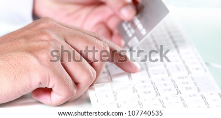 Shopping online using credit card - stock photo