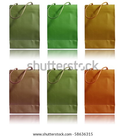 Shopping paper bags in different colors isolated on white - stock photo