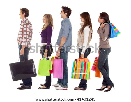shopping people smiling with shopping bags - isolated over a white background - stock photo