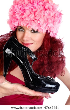 Shopping pretty girl holding a black high heel shoe in her hand and looking at him. Isolated on white background. - stock photo
