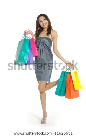 Shopping pretty woman with colored package