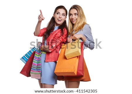 shopping, sale and gifts concept - two smiling teenage girls with shopping bags - stock photo