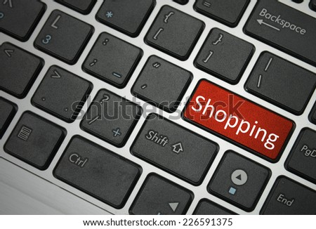 shopping, sale business or ecommerce concept with red button on keyboard