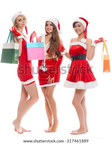 shopping, sale, gifts, christmas, x-mas concept - smiling female in red costumes santa with colorful shopping bags - stock photo