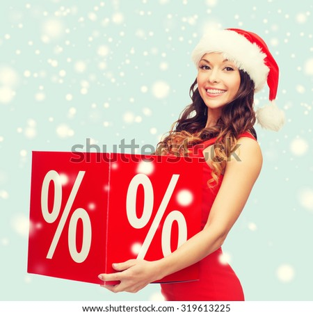 shopping, sale, gifts, christmas, x-mas concept - smiling woman in santa helper hat with percent sign - stock photo