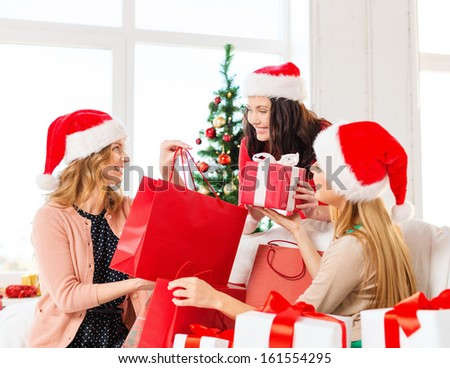 shopping, sale, gifts, christmas, x-mas concept - smiling women in santa helper hats with shopping bags and many gift boxes - stock photo