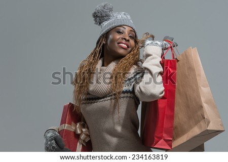 Shopping, sale, gifts, christmas, xmas concept - smiling woman in knitted dress with shopping bags - stock photo
