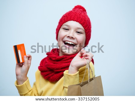 Shopping, sale, holiday concept - smiling girl with shopping bags and plastic card - stock photo