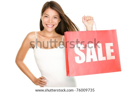 Shopping sale woman showing shopping bag with sale written. Beautiful smiling asian woman showing red shopping bags. Mixed Chinese Asian Caucasian female model isolated on white background. - stock photo