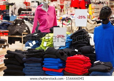 shopping, seasonal sale in the shop - stock photo