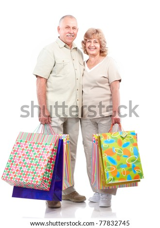 Shopping seniors couple . Isolated over white background - stock photo