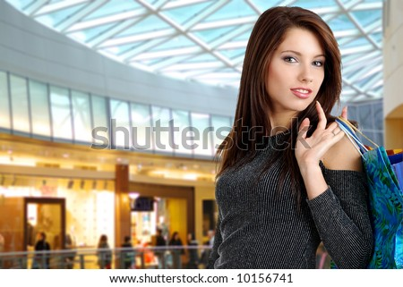 Shopping sexy girl  smiling in the shopping mall. - stock photo