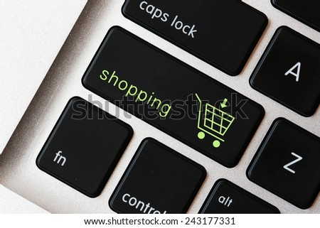 Shopping sign on the keyboard, Online shopping concepts with cart symbol on the keyboard - stock photo