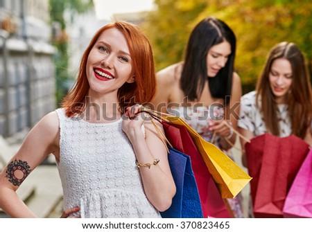 Shopping smiling woman - stock photo