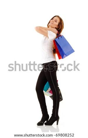 shopping teen girl smiling holding bags full-length isolated on white background - stock photo
