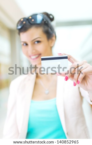 Shopping time, woman with credit card at mall, focus on credit card - stock photo
