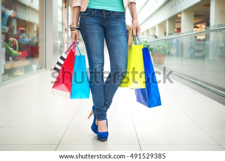 Shopping time, women legs in mall, shallow dof