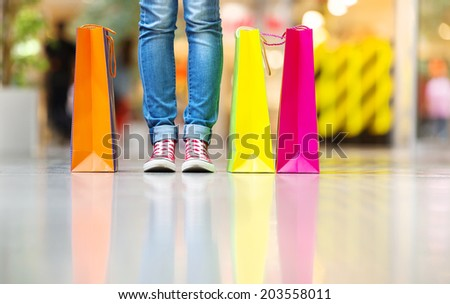 Shopping time, young teenage girl with shopping bags at shopping mall - stock photo