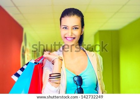 Shopping time, young woman at mall - stock photo