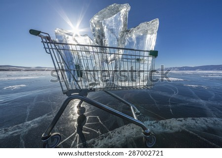 Shopping trolley full of clear ice on a frozen lake Baikal - stock photo