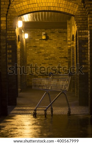 shopping trolley left outside the shop. people more often choose to shop online - stock photo