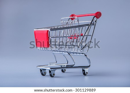 Shopping trolley. Shopping cart. Shopping trolley on muti collored background. Free space for your informations - stock photo