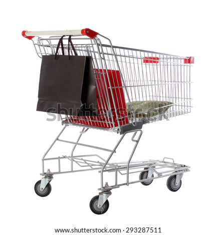 Shopping trolley with bags, isolated on white - stock photo